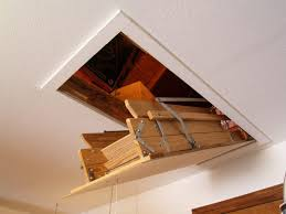 furniture wooden folding attic stairs with hand hold and door as