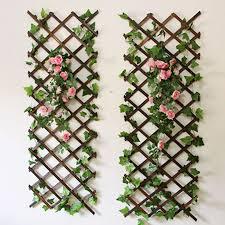 natural wood wall trellis expanding garden flower plant climbing