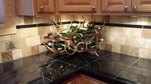 corner counter top wine rack made of decorative antler decofurnish