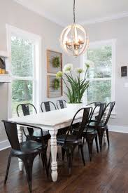 black dining table with white chairs with concept picture 10571