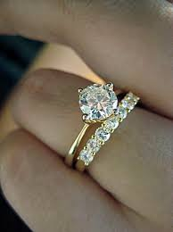wedding band that will go with my east west oval e ring my anniversary band harry winston engagement and ring