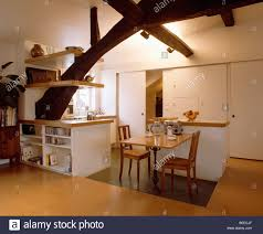 wooden table and chairs in white loft kitchen dining room with