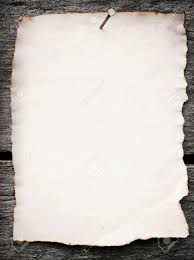 old paper nailed to a grunge wooden background stock photo