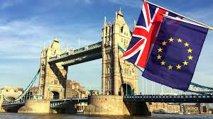 With All Flags Flying European Union And British Union Jack Flag Flying In Front Of