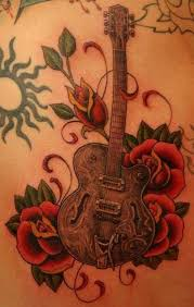 guitar tattoos make musical body art tattoo articles ratta tattoo