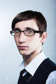 cute young guy with fashion haircut wearing glasses stock photo