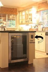 ash wood ginger prestige door kitchen island with wine fridge