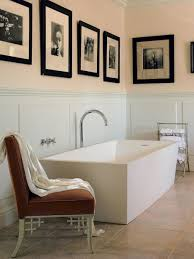 attic bathrooms with white oval standing tubs under untreated