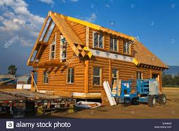 log house under construction kalispell montana usa stock photo