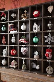 display your ornaments in a shallow shelf with many small