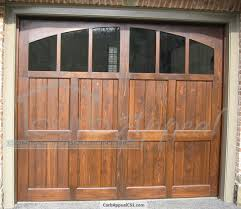 stained cedar carriage style garage door glass and arched top