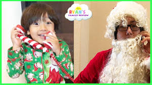 call from santa kid decorating christmas tree with twin baby