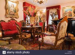 antique furniture furnishings adorn a living room inside a