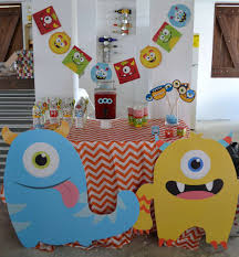 a colorful celebration for a first birthday our little monsters