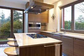 decor kitchen island and cooktop with akdy range hood also window