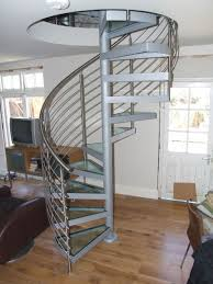interior wooden spiral stairs with glass steps for square space