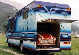 awesome car garages 8 awesome car carrying motorhomes you must see rvshare com