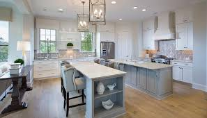 kitchens with 2 islands white kitchen with two gray islands transitional kitchen