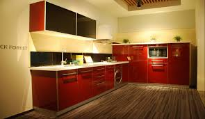 red kitchen with dark cabinets