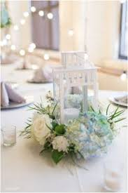 white lantern centerpieces white lantern with hydrangea wedding table centerpiece