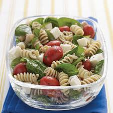 spinach tomato and fresh mozzarella pasta salad with italian