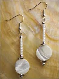 in earrings white is essential and goes with everything beautiful coin shell