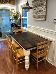 the baluster turned leg table is crafted from solid wood and