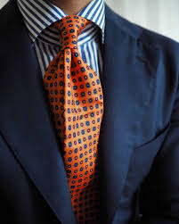 wide tie navy suit navy and white striped shirt orange with blue and
