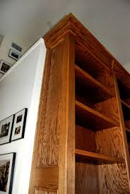Rolling Ladder Bookcase by Custom Bookcase With Rolling Ladder By Dk Kustoms Inc Custommade Com