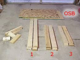 Plans For Building A Wooden Workbench by How To Build A Low Cost Sturdy Work Bench From 2x4 U0027s And Osb