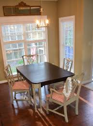 ebony table and chairs down to earth style ebony stain top fossil spray paint legs