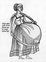 pregnant woman using a hoop to support photograph by everett