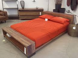 cherry finished wooden flat platform bed built in side tables