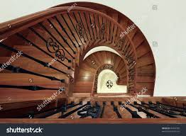 cherry wood spiral staircase black railing stock photo 47444185