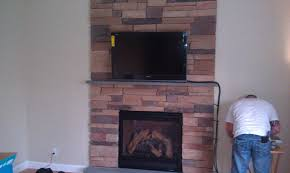 stone fireplace with tv mounted fireplace design and ideas