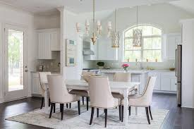 Dining Room Chandeliers Transitional White Farmhouse Dining Table With Glass And Brass Chandelier