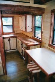 trophy amish cabins llc interiors 10 wide interior shown below with optional built in bunk bed pine faced roll out drawers changing room with loft above cabinet stools deluxe
