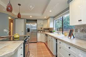 white shaker kitchen cabinets to ceiling second floor kitchen boasts tray ceiling island and white shaker