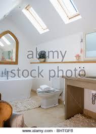 Bathroom In Loft Conversion Velux Windows In Modern White Loft Conversion Bathroom With Wooden