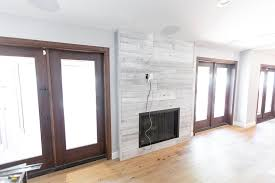 distressed white iowa pine wood wall w steel fireplace frame