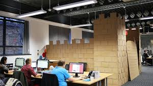 your desk has nothing on this cubicle turned cardboard castle co