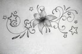 stars and lily flowers tattoo design