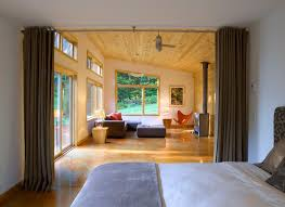 studio apartment dividers bedroom modern with ceiling fan vaulted