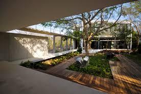 wide courtyard casa entre árboles near wooden deck along near