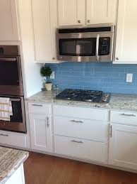 Sky Blue Glass Subway Tile Backsplash In Modern White Kitchen - Blue glass tile backsplash