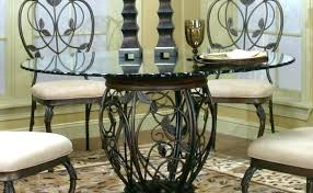 Wrought Iron Dining Table And Chairs Wrought Iron And Glass Dining Table Dining Tables Contemporary
