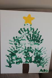 handprint christmas tree painted by my 2 year old it u0027s a holly
