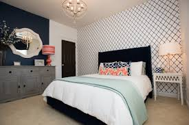 new south design fall 2015 home decor trends navy trellis wallpaper and upholstered headboard yes please room design by new south home