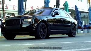 bentley ghost coupe all black rr phantom driving on ocean drive in miami beach florida