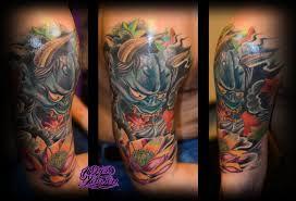 demon mask tattoo